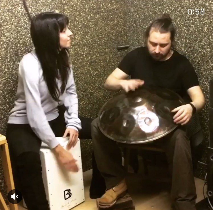 Playing cajon and handpan